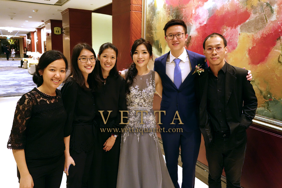 String Quartet playing grand march-in music for wedding at Shangri La Hotel Singapore