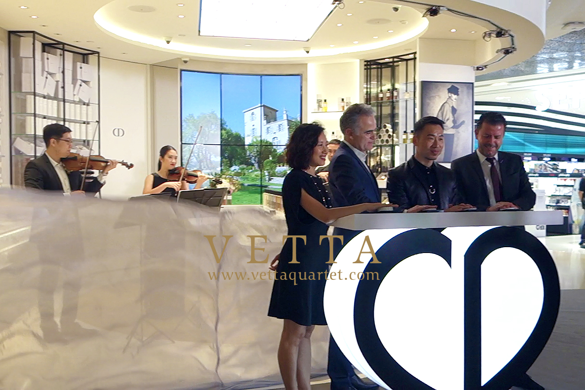 VETTA String Quartet playing during Kabuki drop for Dior Grand Opening at ION