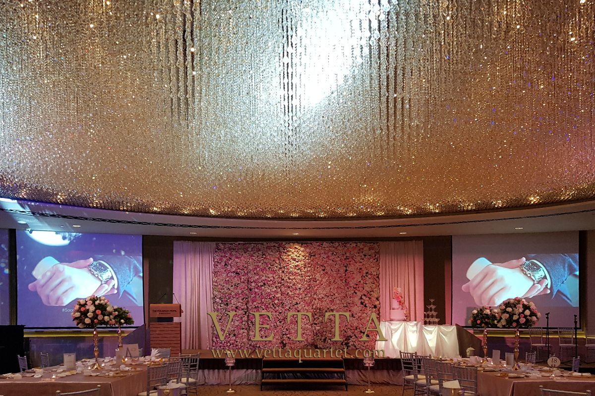 Four String Musicians playing background music for wedding at Fullerton Hotel Singapore