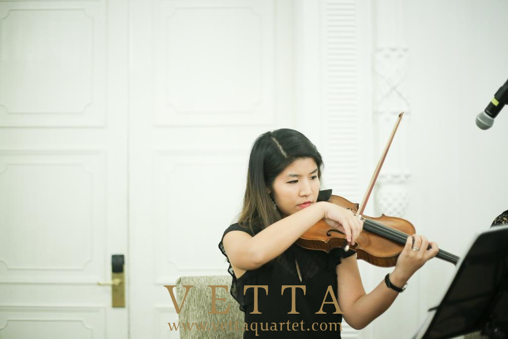 String Violinist playing cocktail music at Fullerton Hotel