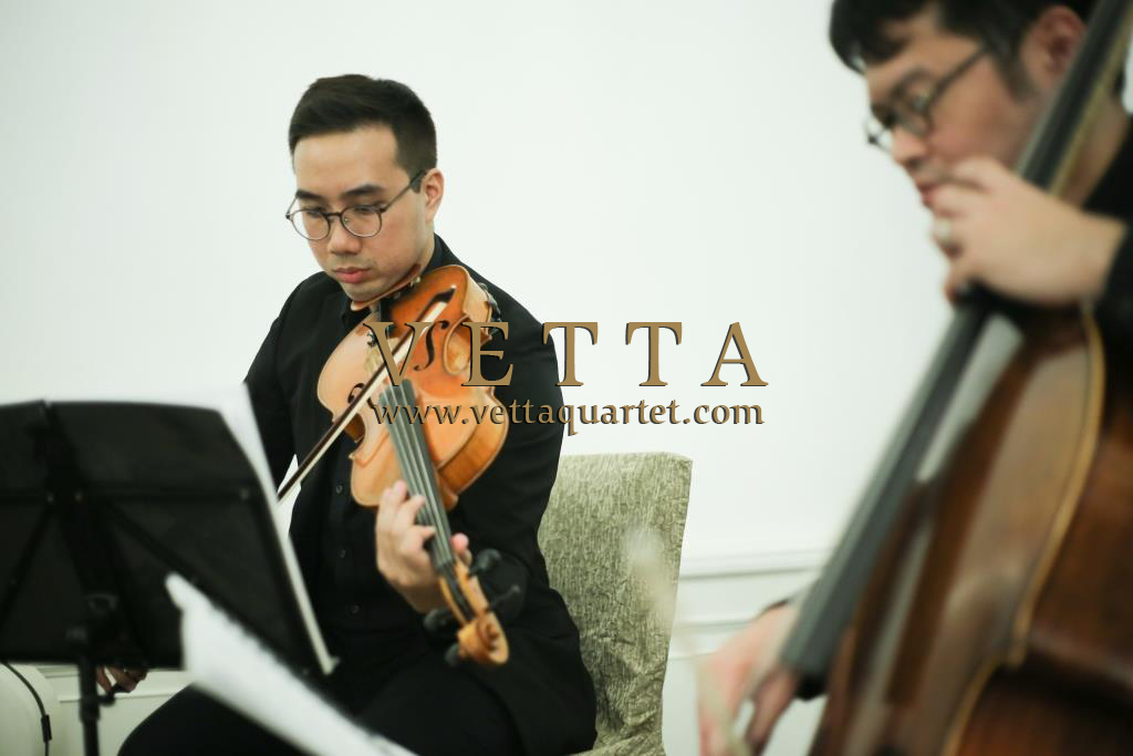String Quartet Violist and Cellist playing background music at corporate booking Fullerton Hotel Singapore