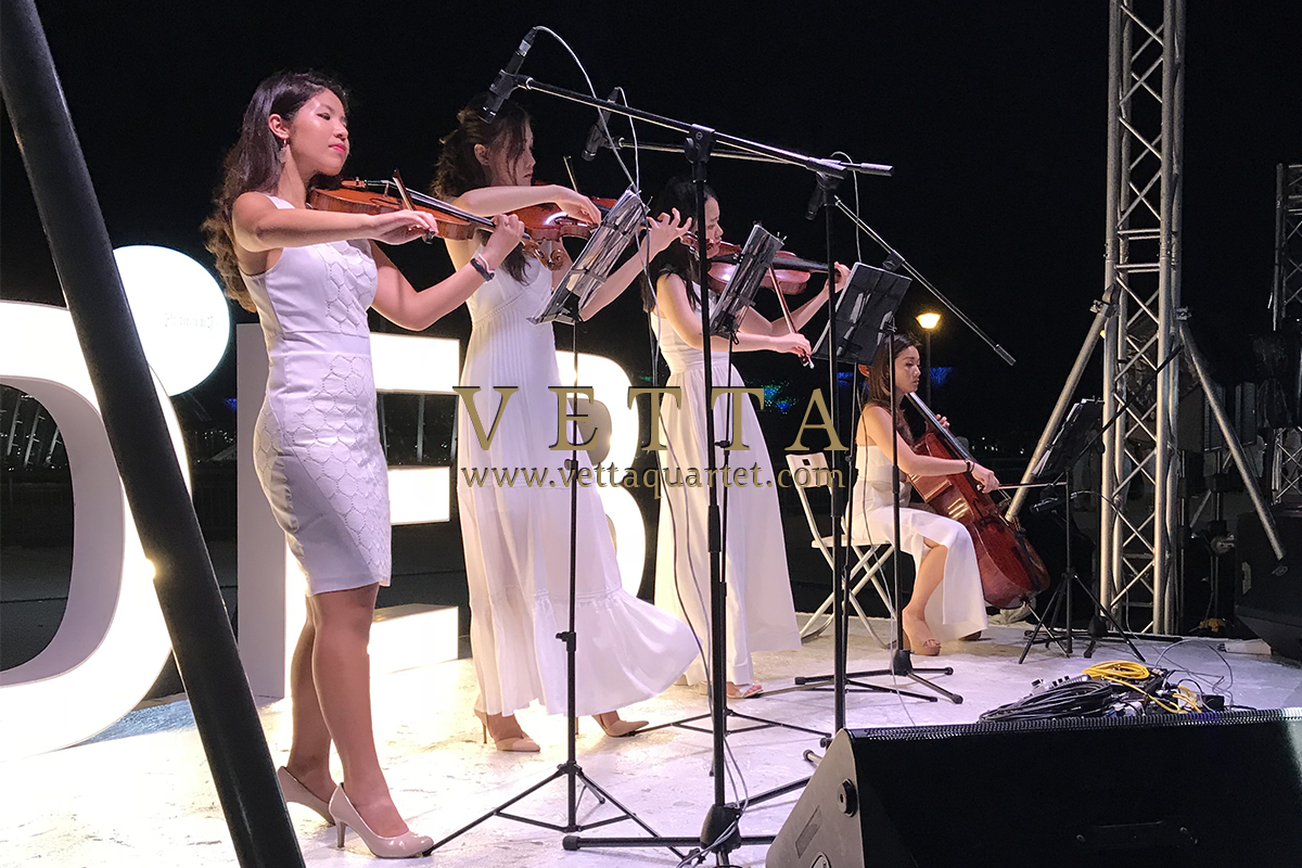 All ladies String Quartet performing on stage at Diner En Blanc Singapore